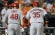 Aug 8, 2014; Baltimore, MD, USA; St. Louis Cardinals A.J. Pierzynski (35) and Tony Cruz (48) walks to the dugout after Pierzynski hits a two-run home run in the seventh inning against the Baltimore Orioles at Oriole Park at Camden Yards. The Orioles won 12-2. Mandatory Credit: Joy R. Absalon-USA TODAY Sports