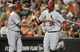 Aug 8, 2014; Baltimore, MD, USA; St. Louis Cardinals A.J. Pierzynski (35) celebrates with third base coach Jose Oquendo (11) after hitting a two-run home run in the seventh inning against the Baltimore Orioles at Oriole Park at Camden Yards. The Orioles won 12-2. Mandatory Credit: Joy R. Absalon-USA TODAY Sports