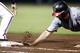 Aug 8, 2014; Atlanta, GA, USA; Washington Nationals left fielder Kevin Frandsen (19) dives safely back to first against the Atlanta Braves in the seventh inning at Turner Field. Mandatory Credit: Brett Davis-USA TODAY Sports