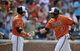 Aug 9, 2014; Baltimore, MD, USA; Baltimore Orioles designated hitter Nelson Cruz (23) is congratulated by Chris Davis (19) after hitting a two-run home run in the third inning against the St. Louis Cardinals at Oriole Park at Camden Yards. Mandatory Credit: Joy R. Absalon-USA TODAY Sports