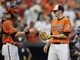 Aug 9, 2014; Baltimore, MD, USA; Baltimore Orioles catcher Caleb Joseph (36) congratulates pitcher Brad Brach (35) after a game against the St. Louis Cardinals at Oriole Park at Camden Yards. The Orioles defeated the Cardinals 10-3. Mandatory Credit: Joy R. Absalon-USA TODAY Sports