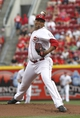 Aug 9, 2014; Cincinnati, OH, USA; Cincinnati Reds starting pitcher Alfredo Simon (31) throws a pitch against the Miami Marlins in the first inning at Great American Ball Park. Mandatory Credit: David Kohl-USA TODAY Sports