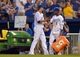 Aug 9, 2014; Kansas City, MO, USA; Kansas City Royals starting pitcher James Shields (33) is congratulated by center fielder Jarrod Dyson (1) after having a cooler dumped on him after the game against the San Francisco Giants at Kauffman Stadium. The Royals won 5-0. Mandatory Credit: Denny Medley-USA TODAY Sports