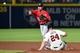 Aug 9, 2014; Atlanta, GA, USA; Washington Nationals shortstop Ian Desmond (20) turns a double play over Atlanta Braves catcher Evan Gattis (24) during the second inning at Turner Field. Mandatory Credit: Dale Zanine-USA TODAY Sports