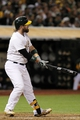 Aug 9, 2014; Oakland, CA, USA; Oakland Athletics catcher Derek Norris (36) hits a three run home run in the sixth inning of their MLB baseball game with the Minnesota Twins at O.co Coliseum. Mandatory Credit: Lance Iversen-USA TODAY Sports