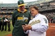 Aug 9, 2014; Oakland, CA, USA; Oakland Athletics former manager Tony La Russa (right) talks with current manager Bob Melvin prior to a pre-game ceremony honoring La Russa's recent induction into the Baseball Hall of Fame  at O.co Coliseum. Mandatory Credit: Lance Iversen-USA TODAY Sports