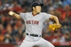 August 9, 2014; Anaheim, CA, USA; Boston Red Sox relief pitcher Koji Uehara (19) pitches the twelfth inning against the Los Angeles Angels at Angel Stadium of Anaheim. Mandatory Credit: Gary A. Vasquez-USA TODAY Sports