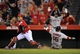 August 9, 2014; Anaheim, CA, USA; Boston Red Sox second baseman Dustin Pedroia (15) scores a run past Los Angeles Angels catcher  Hank Conger (24) in the fourteenth inning  at Angel Stadium of Anaheim. Mandatory Credit: Gary A. Vasquez-USA TODAY Sports
