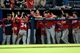 Aug 9, 2014; Atlanta, GA, USA; Washington Nationals players and coaches react to taking the lead against the Atlanta Braves during the eleventh inning at Turner Field. The Nationals defeated the Braves 4-1 in eleven innings. Mandatory Credit: Dale Zanine-USA TODAY Sports
