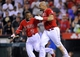 August 9, 2014; Anaheim, CA, USA; Los Angeles Angels first baseman Albert Pujols (5) celebrates with shortstop Erick Aybar (2) after he hits a solo home run in the nineteenth inning for the 5-4 victory against the Boston Red Sox at Angel Stadium of Anaheim. Mandatory Credit: Gary A. Vasquez-USA TODAY Sports
