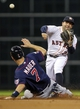 Aug 11, 2014; Houston, TX, USA; Minnesota Twins first baseman Joe Mauer (7) is out at second base as Houston Astros second baseman Jose Altuve (27) throws to first base during the first inning at Minute Maid Park. Mandatory Credit: Troy Taormina-USA TODAY Sports