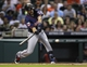 Aug 11, 2014; Houston, TX, USA; Minnesota Twins third baseman Trevor Plouffe (24) drives in a run with a fielders choice during the first inning against the Houston Astros at Minute Maid Park. Mandatory Credit: Troy Taormina-USA TODAY Sports