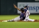 Aug 11, 2014; Houston, TX, USA; Minnesota Twins shortstop Eduardo Escobar (5) slides safely into second base during the fourth inning as Houston Astros shortstop Gregorio Petit (3) attempts to apply the tag at Minute Maid Park. Mandatory Credit: Troy Taormina-USA TODAY Sports