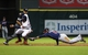 Aug 11, 2014; Houston, TX, USA; Houston Astros second baseman Jose Altuve (27) slides safely into second base on a sacrifice fly as Minnesota Twins shortstop Eduardo Escobar (5) attempts to apply the tag at Minute Maid Park. Mandatory Credit: Troy Taormina-USA TODAY Sports