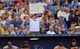 Aug 9, 2014; Kansas City, MO, USA; San Francisco Giants right fielder Hunter Pence (8) fans hold up troll signs during the game against the Kansas City Royals at Kauffman Stadium. The Royals won 5-0. Mandatory Credit: Denny Medley-USA TODAY Sports