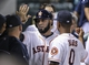 Aug 12, 2014; Houston, TX, USA; Houston Astros shortstop Marwin Gonzalez (9) is congratulated in the dugout after scoring a run during the fifth inning against the Minnesota Twins at Minute Maid Park. Mandatory Credit: Troy Taormina-USA TODAY Sports