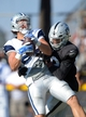 Aug 12, 2014; Oxnard, CA, USA; Dallas Cowboys tight end Dallas Walker (86) is defended by Oakland Raiders cornerback Keith McGill (39) at scrimmage against the Dallas Cowboys at River Ridge Fields. Mandatory Credit: Kirby Lee-USA TODAY Sports