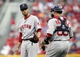 Aug 12, 2014; Cincinnati, OH, USA; Boston Red Sox catcher Christian Vazquez (55) goes to the mound to talk to starting pitcher Joe Kelly (56) during the first inning at Great American Ball Park. Mandatory Credit: Frank Victores-USA TODAY Sports