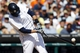 Aug 14, 2014; Detroit, MI, USA; Detroit Tigers left fielder J.D. Martinez (28) breaks his bat as he hits a hits an RBI single in the eighth inning against the Pittsburgh Pirates at Comerica Park. Mandatory Credit: Rick Osentoski-USA TODAY Sports