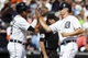 Aug 14, 2014; Detroit, MI, USA; Detroit Tigers designated hitter Victor Martinez (41) and Don Kelly (32) congratulate each other after scoring in the eighth inning against the Pittsburgh Pirates at Comerica Park. Mandatory Credit: Rick Osentoski-USA TODAY Sports