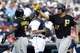 Aug 14, 2014; Detroit, MI, USA; Pittsburgh Pirates pinch hitter Gaby Sanchez (17) receives congratulations from third baseman Josh Harrison (5) after he hit a two run home run in the ninth inning against the Detroit Tigers at Comerica Park. Detroit won 5-2. Mandatory Credit: Rick Osentoski-USA TODAY Sports
