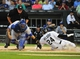 Aug 15, 2014; Chicago, IL, USA; Chicago White Sox right fielder Dayan Viciedo (24) scores as Toronto Blue Jays catcher Dioner Navarro (30) makes a late tag during the first inning at U.S Cellular Field. Mandatory Credit: David Banks-USA TODAY Sports
