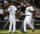 Aug 15, 2014; Chicago, IL, USA; Chicago White Sox shortstop Alexei Ramirez (10) greets center fielder Jordan Danks (20) after scoring against the Toronto Blue Jays during the fifth inning at U.S Cellular Field. Mandatory Credit: David Banks-USA TODAY Sports