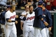 Aug 15, 2014; Cleveland, OH, USA; Cleveland Indians left fielder Mike Aviles (center) celebrates after hitting a game winning home run during the eleventh inning against the Baltimore Orioles at Progressive Field. The Indians won 2-1. Mandatory Credit: Ken Blaze-USA TODAY Sports