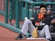 Aug 16, 2014; Cleveland, OH, USA; Baltimore Orioles third baseman Manny Machado (13) watches from the dugout in the second inning against the Cleveland Indians at Progressive Field. Mandatory Credit: David Richard-USA TODAY Sports