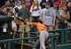 Aug 16, 2014; Cleveland, OH, USA; Fans look on as Baltimore Orioles third baseman Ryan Flaherty (3) reaches for a foul ball in the eighth inning against the Cleveland Indians at Progressive Field. Mandatory Credit: David Richard-USA TODAY Sports