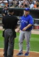 Aug 17, 2014; Chicago, IL, USA; Toronto Blue Jays manager John Gibbons (5) questions a call with umpire Clint Fagan (82) during the first inning of a game against the Chicago White Sox at U.S Cellular Field. Mandatory Credit: David Banks-USA TODAY Sports