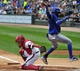 Aug 17, 2014; Chicago, IL, USA; Toronto Blue Jays shortstop Jose Reyes (7) is safe at home as Chicago White Sox catcher Adrian Nieto (17) makes a tag during the first inning at U.S Cellular Field. Mandatory Credit: David Banks-USA TODAY Sports