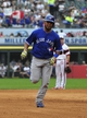 Aug 17, 2014; Chicago, IL, USA; Toronto Blue Jays designated hitter Edwin Encarnacion (10) runs the bases after hitting two-run homer against the Chicago White Sox during the fifth inning at U.S Cellular Field. Mandatory Credit: David Banks-USA TODAY Sports