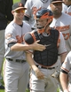 Aug 17, 2014; Cleveland, OH, USA; Baltimore Orioles catcher Caleb Joseph (left) and catcher Nick Hundley (40) celebrate a 4-1 win over the Cleveland Indians at Progressive Field. Mandatory Credit: David Richard-USA TODAY Sports