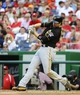 Aug 17, 2014; Washington, DC, USA; Pittsburgh Pirates second baseman Neil Walker (18) grounds into a fielders choice scoring a run against the Washington Nationals during the sixth inning at Nationals Park. Mandatory Credit: Brad Mills-USA TODAY Sports