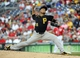 Aug 17, 2014; Washington, DC, USA; Pittsburgh Pirates starting pitcher Edinson Volquez (36) throws during the sixth inning against the Washington Nationals at Nationals Park. Mandatory Credit: Brad Mills-USA TODAY Sports