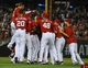Aug 17, 2014; Washington, DC, USA; Washington Nationals left fielder Scott Hairston (7) is mobbed by teammates after hitting a walk off sacrifice flay against the Pittsburgh Pirates during the eleventh inning at Nationals Park. The Nationals won 6-5. Mandatory Credit: Brad Mills-USA TODAY Sports
