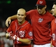 Aug 17, 2014; Washington, DC, USA; Washington Nationals left fielder Scott Hairston (7) is congratulated by starting pitcher Doug Fister (right) after hitting a walk off sacrifice fly against the Pittsburgh Pirates during the eleventh inning at Nationals Park. The Nationals won 6-5. Mandatory Credit: Brad Mills-USA TODAY Sports