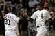 Aug 18, 2014; Chicago, IL, USA; Chicago White Sox left fielder Alejandro De Aza (30) and shortstop Alexei Ramirez (10) high five after both scoring on a 2-run RBI single by right fielder Avisail Garcia (not pictured) at U.S Cellular Field. Mandatory Credit: Jon Durr-USA TODAY Sports