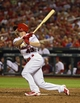 Aug 19, 2014; St. Louis, MO, USA; St. Louis Cardinals pinch hitter Shane Robinson (43) hits a one run single off of Cincinnati Reds relief pitcher Sam LeCure (not pictured) during the sixth inning at Busch Stadium. Mandatory Credit: Jeff Curry-USA TODAY Sports