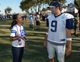 Aug 12, 2014; Oxnard, CA, USA; Dallas Cowboys quarterback Tony Romo (9) and Ilyne Nash at scrimmage against the Oakland Raiders at River Ridge Fields. Nash is the girlfriend of Cowboys receiver Dez Bryant (not pictured). Mandatory Credit: Kirby Lee-USA TODAY Sports