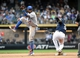 Aug 20, 2014; Milwaukee, WI, USA;  Toronto Blue Jays shortstop Jose Reyes (7) gets away from Milwaukee Brewers shortstop Jean Segura (9) after forcing him out at 2nd base in the eighth inning at Miller Park. Mandatory Credit: Benny Sieu-USA TODAY Sports