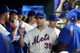 Aug 26, 2014; New York, NY, USA; New York Mets starting pitcher Dillon Gee (35) gets high fives in the dugout after being removed from the game during the seventh inning of a game against the Atlanta Braves at Citi Field. The Mets defeated the Braves 3-2. Mandatory Credit: Brad Penner-USA TODAY Sports