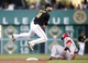 Aug 29, 2014; Pittsburgh, PA, USA; Pittsburgh Pirates second baseman Neil Walker (18) leaps to avoid Cincinnati Reds catcher Devin Mesoraco (39) after throwing to first base during the second inning at PNC Park. Mandatory Credit: Charles LeClaire-USA TODAY Sports