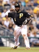 Aug 29, 2014; Pittsburgh, PA, USA; Pittsburgh Pirates third baseman Josh Harrison (5) throws to first base to retire Cincinnati Reds third baseman Todd Frazier (not pictured) during the fourth inning at PNC Park. Mandatory Credit: Charles LeClaire-USA TODAY Sports