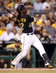 Aug 29, 2014; Pittsburgh, PA, USA; Pittsburgh Pirates center fielder Andrew McCutchen (22) hits a single to center field against the Cincinnati Reds during the fourth inning at PNC Park. Mandatory Credit: Charles LeClaire-USA TODAY Sports