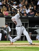 Aug 29, 2014; Chicago, IL, USA; Detroit Tigers right fielder Torii Hunter (48) hits an RBI sacrifice against the Chicago White Sox during the third inning at U.S Cellular Field. Mandatory Credit: David Banks-USA TODAY Sports