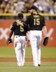Aug 29, 2014; Pittsburgh, PA, USA; Pittsburgh Pirates third baseman Josh Harrison (5) and first baseman Ike Davis (15) react after defeating the Cincinnati Reds at PNC Park. The Pirates won 2-1. Mandatory Credit: Charles LeClaire-USA TODAY Sports