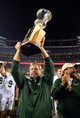 Aug 29, 2014; Denver, CO, USA; Colorado State Rams head coach Jim McElwain reacts with the Centennial Cup following the win over the Colorado Buffaloes at Sports Authority Field at Mile High. Mandatory Credit: Ron Chenoy-USA TODAY Sports