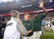 Aug 29, 2014; Denver, CO, USA; Colorado State Rams head coach Jim McElwain greats Colorado Buffaloes head coach Mike MacIntyre following the game at Sports Authority Field at Mile High. The Rams defeated the Buffaloes 31-17. Mandatory Credit: Ron Chenoy-USA TODAY Sports